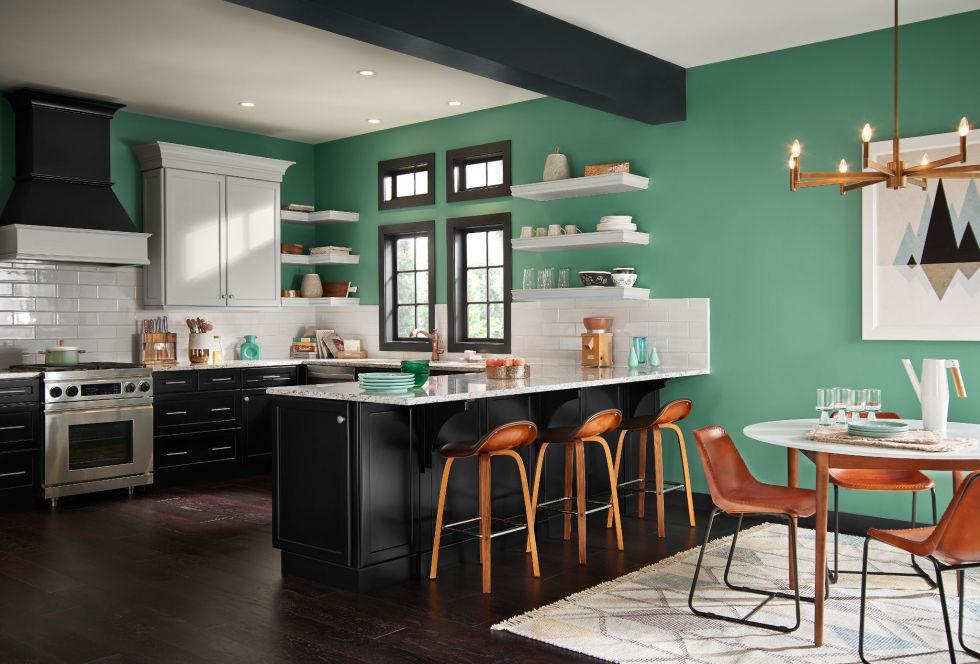 cozinha-com-ilha-preta-e-paredes-verdes