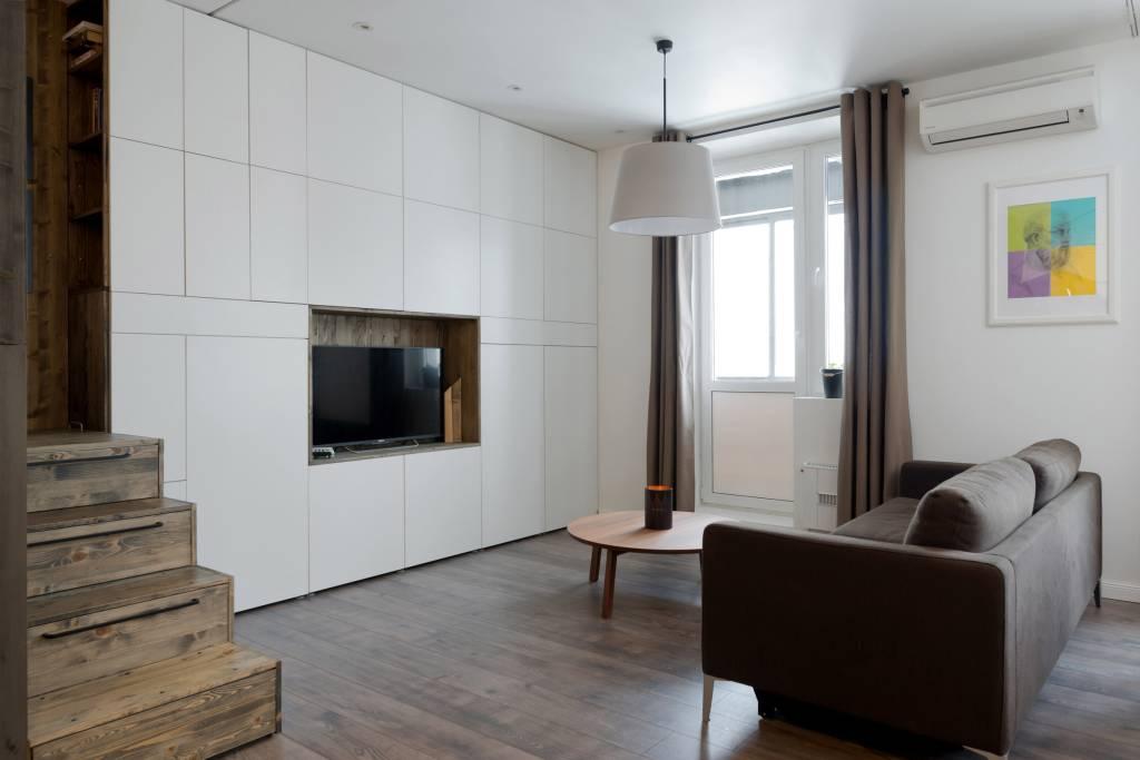 03neste-apartamento-a-cama-foi-instalada-em-uma-caixa-de-madeira